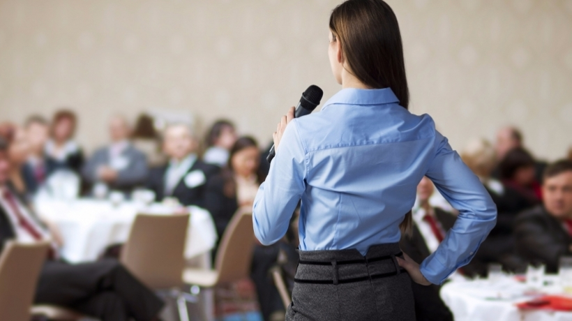 20150720143913-woman-speaking-conference-crowd